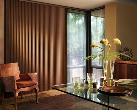 """These honeycomb shades are distinguished by dramatic 1 ¼"""" pleats, exclusive sheer, textured and Opalessence™ fabrics and hardware finishes. Available with Vertiglide™ vertical pleat window treatment system featured on our Duette® honeycomb shades, is the ideal choice for side-to-side openings, sliding glass doors or as a room divider."""