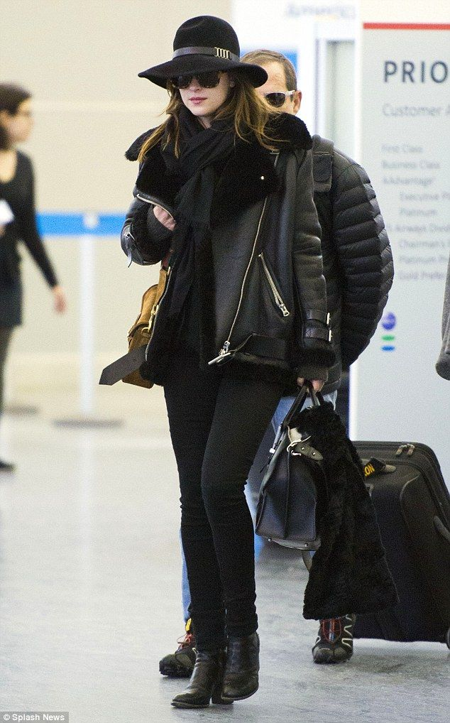 Arrivals: Dakota Johnson arrived at New York's JFK airport on Monday following the Oscars ...
