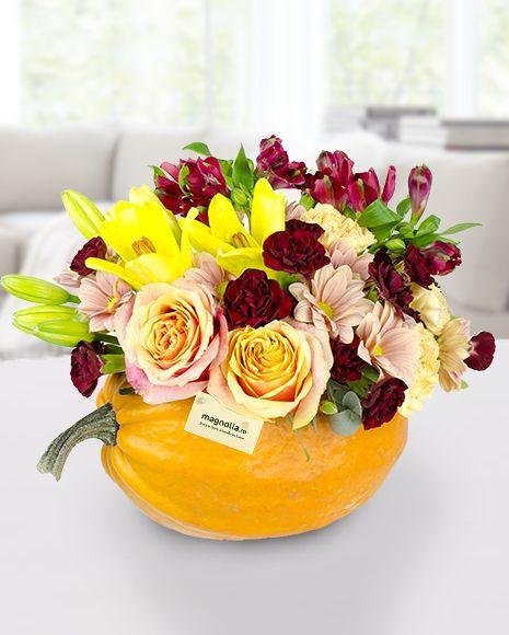 Flower arrangement in a pumpkin. Made by our florists for Halloween. Everybody will love it!  Aranjament cu flori mix în dovleac. A fost creat de floristii nostri si este un cadou de Halloween pe care oricine l-ar aprecia!