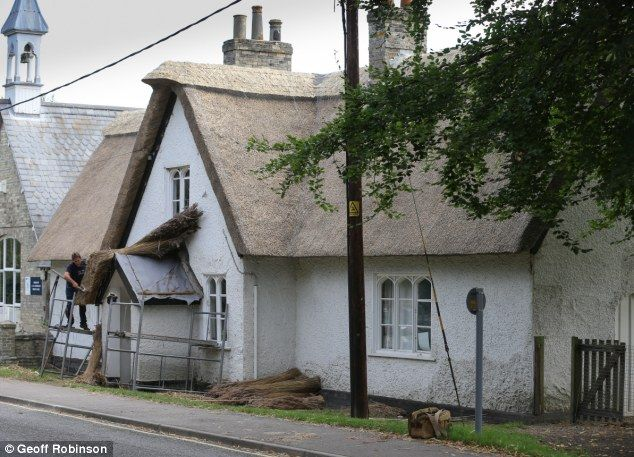 One of Britain's last schools with a thatched roof is spruced up for new term after replacement reeds were put in during holidays