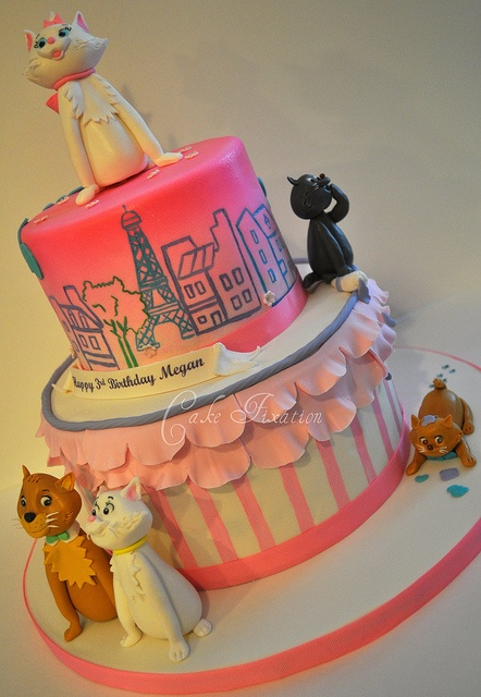 aristocats.  not for my big wedding cake, but maybe for a kids' cake?  i know that people don't normally do that, but somehow i don't think this would fly as a groom's cake.
