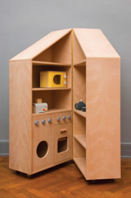 Love this bookshelf play kitchen for kids! When they're done playing, it closes back up for storage.