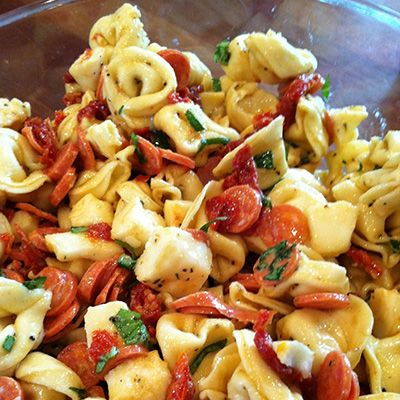Tortellini and Pepperoni Pasta Salad 1 (20-ounce) package refrigerated cheese tortellini 1C fresh mozzarella, cubed 1C pepperoni, chopped 1C cherry tomatoes cut in half 1/3C fresh basil, chopped 2/3C Caesar salad dressing Salt and pepper to taste
