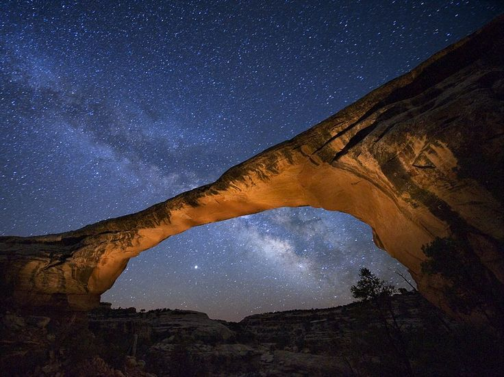 "A starry night gleams above Owachomo Bridge in Utah's Natural Bridges National Monument—named the first Dark Sky Park by the International Dark-Sky Association (IDA). ""Here you see something forgotten,"" says ranger Scott Ryan, ""and reconnect with the sky."" Photograph by Jim Richardson, National Geographic. September 13, 2013"