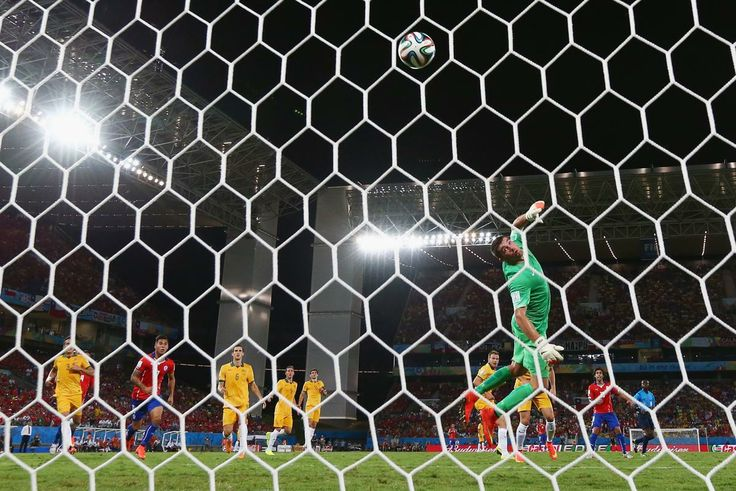Chile v Australia: Group B - 2014 FIFA World Cup Brazil - Jorge Valdivia of Chile shoots and scores his teams second goal against goalkeeper Mathew Ryan of Australia during the 2014 FIFA World Cup Brazil Group B match between Chile and Australia at Arena Pantanal on June 13, 2014 in Cuiaba, Brazil. (Matthew Lewis/Getty Images)