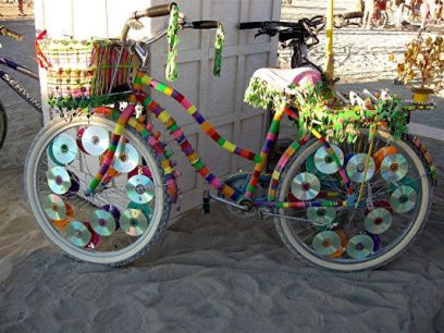 bike decorating ideas - the CDs on the spokes are GENIUS!!!