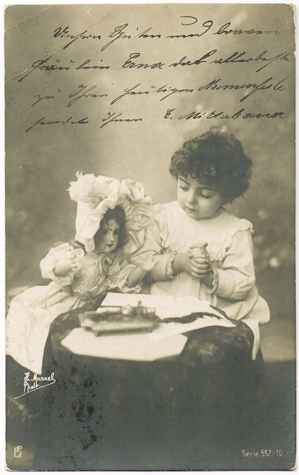 Lovely old postcard, depicting a little girl and her doll.Photo by H. Manuel. Used as postcard in Austria in 1905. Good condition.