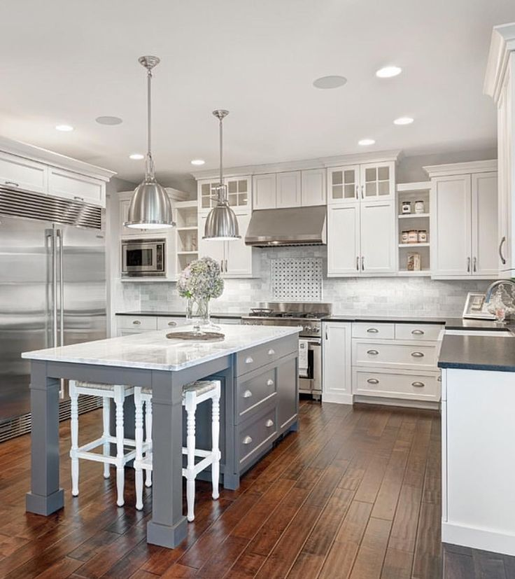 White & marble kitchen with grey island