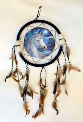 "A beautiful suede and feather dream cather featuring a durable vinyl print of a unicorn in the center. Wood, Leather, Feathers, Vinyl. 13"" x 24"""