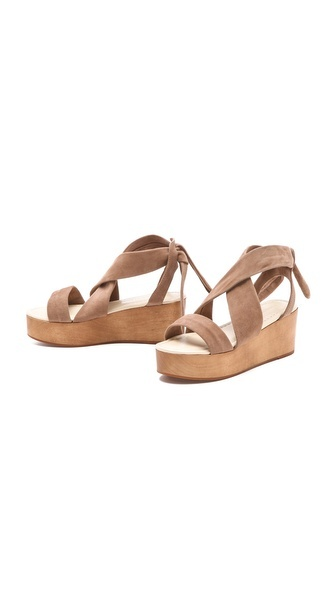 Soft suede straps create clean lines on these flatform sandals from Madison Harding. Wood platform and thick ankle tie. Rubber sole.
