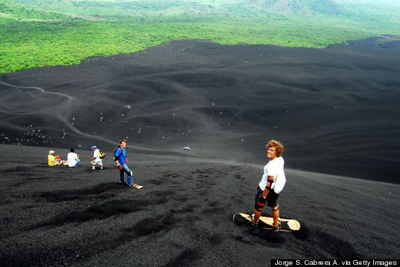 "Nicaragua - Cerro Negro: ""Imagine boarding down the black sandy slopes of one restless volcano in the middle of Central America. Full disclosure: this young volcano is still active, so you know tread with caution; but also: BRING YOUR SANDBOARDS."""