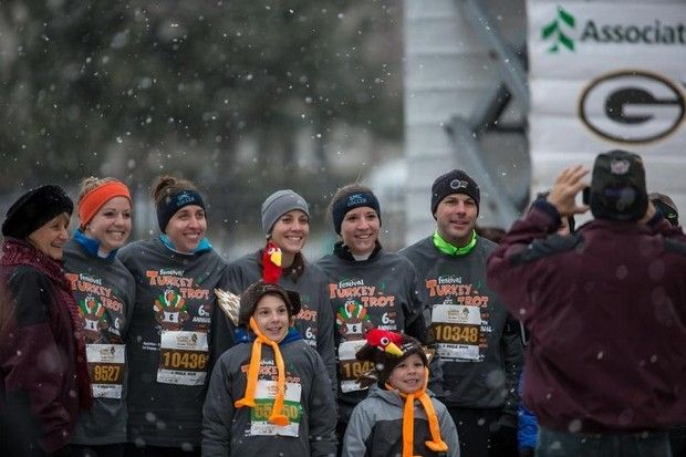 Picture time before the race. The 6th Annual Festival Foods Turkey Trot brought hundreds of runners and walker to downtown Oshkosh early Thanksgiving morning. The event benefits the Oshkosh Boys and Girls Club and YMCA.