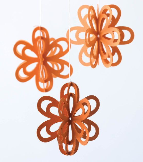 Create easy hanging paper flowers for a little girl's room or party decorations!