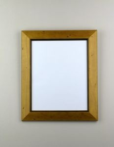 This natural wood picture frame has a Caramel finish and features a dark wood inlay.