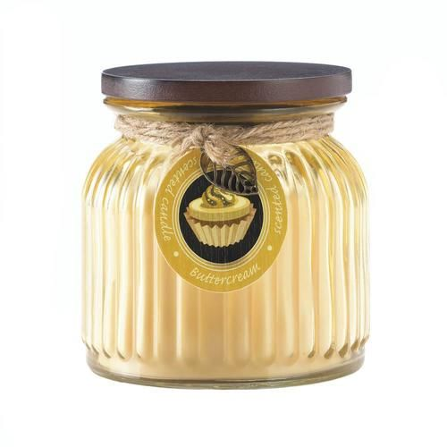 The aroma of freshly frosted cupcakes and the gentle glow of candlelight makes this jar candle a prize. The golden ribbed jar houses a butter cream scented, long-lasting candle. Comes with lid. 16 oz and 100 burn time.