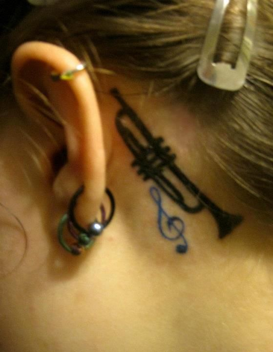 I must have this trumpet tattoo