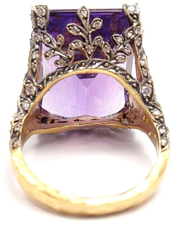 Under view: Cathy Waterman gold, diamond and amethyst winged ring. Via Diamonds in the Library.