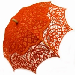 "Battenburg Lace Parasol - Orange, Wood Handle  Price: $54.95   This beautiful parasol is a lightweight, elegant sunshade made from Battenburg Lace. Used for weddings, photography, theatrical performances and garden parties. It features intricate embroidery throughout.  Victorian elegance!  Measures 30"" wide by 26"" length  Metal ribs  Straight wooden handle  Offers decadent shelter from the sun"