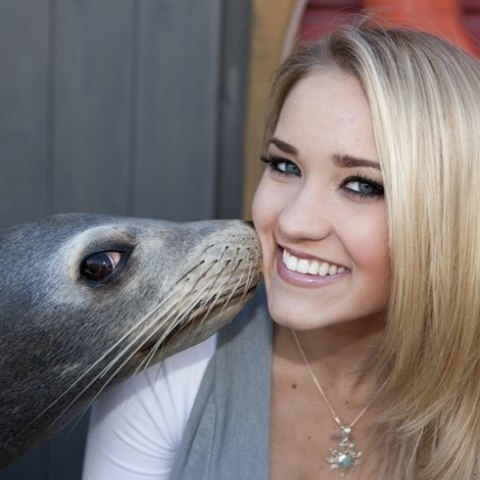 Emily Osment getting kisses from a seal! Lol #socute