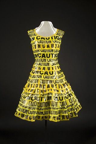 Yasmin Cain: Signalling a strong warning this dress is made from CAUTION tape found on the side of the road. This CAUTION eco-wear took Nancy Judd 50 hours to make. The statement the dress provides is due to the increase in carbon dioxide in 2010. This dress provides clear CAUTION to the fact that the worlds development and efforts are not good enough to slow man-made global warning.  NancyJudd,2011,Caution dress,[online],Available at:www.recyclerunway.com,[accessed:12/2/14]