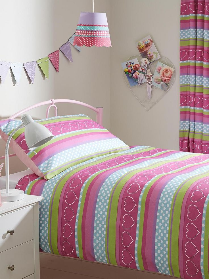 Hearts and Stripes Duvet Cover and Pillowcase Set in Single and Double Sizes - buy one set and get a co-ordinating set FREE! She'll love the cute, colourful design of the Hearts and Stripes bedding range, which oozes pretty vintage style.One duvet cover set flaunts a brightly coloured hearts pattern, while the other features a stripe design embellished with a heart print. Best of all, thanks to our fantastic 2-for-1 offer, when you order one set, we'll send you the other absolutely FREE…
