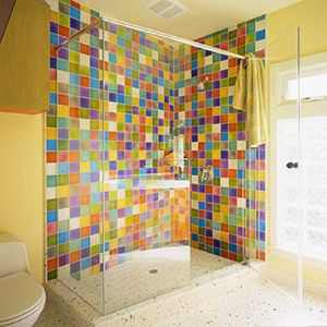 love these tiles...don't like the glass enclosure...maybe a glass tile half wall?