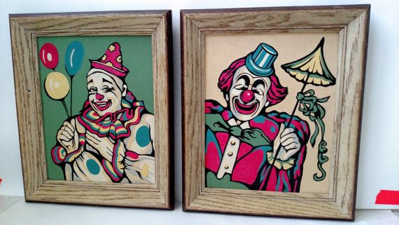 This is a listing for two vintage paintings of clowns with matching frames that were painted by hand during the 1950s. Paintings feature soft colors