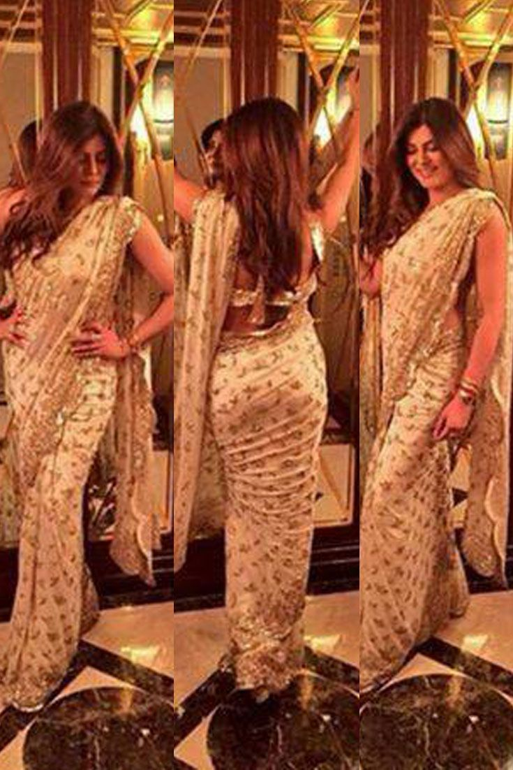 Style Icon Sushmita Sen in a Beige Embroidered Saree designed by Manish Malhotra for a magazine shoot.