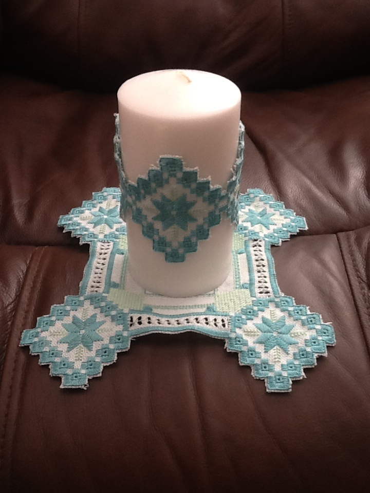 I made this Hardanger candle for my mother-in-law for Christmas. I'm pleased with the colors. The candle will go we'll with her home decor. (My sister made this)