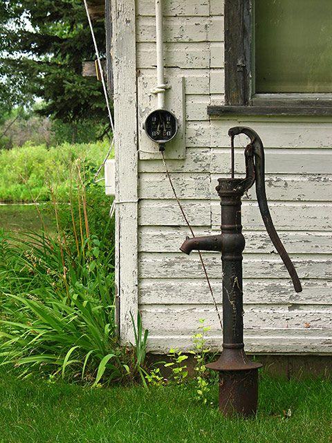 Old Well Pump, vintage siding, peeling paint...