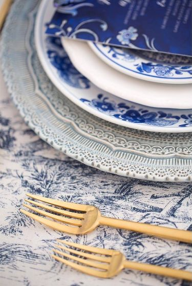 Layering your china creates depth and beauty! Monochromatic blues with a pop of gold is a palette that never goes out of style #eventprofs #tabledecor
