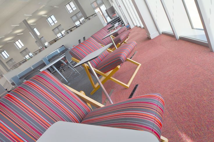 Swansea University: Science & Innovation Bay Campus.  Yolo lounge chairs with Flamingo laptop tables.