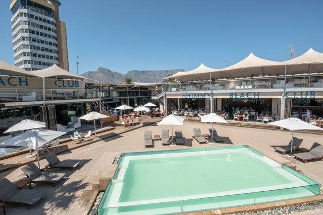Shimmy Beach Club, a premier venue in the V&A Waterfront. Private beach, enjoy your cocktails here, Book a lounger for the day
