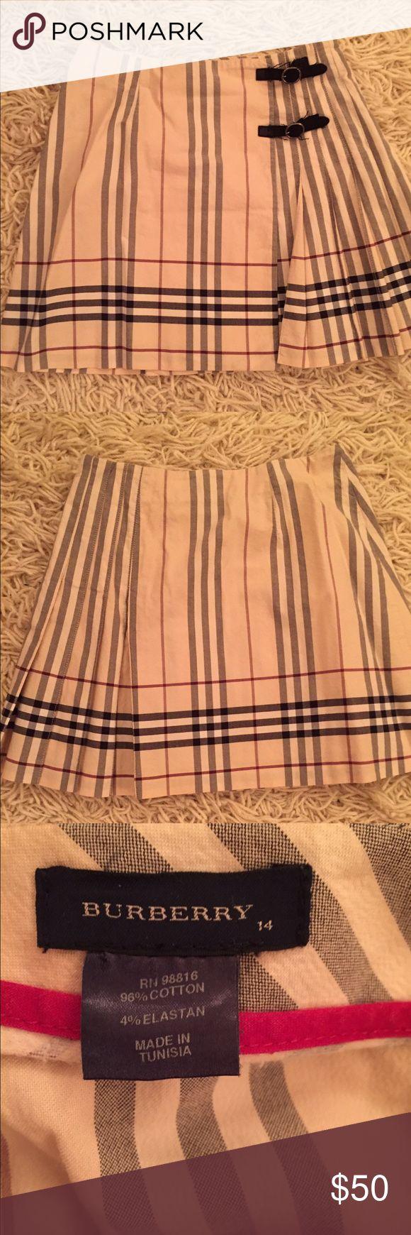 Burberry skirt Classic Burberry plaid skirt that wraps around form the back Burberry Skirts Mini