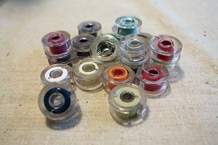 Simply ingenious idea for making bobbin covers - no more spiderwebs of thread. Duh....this is so cool!!!