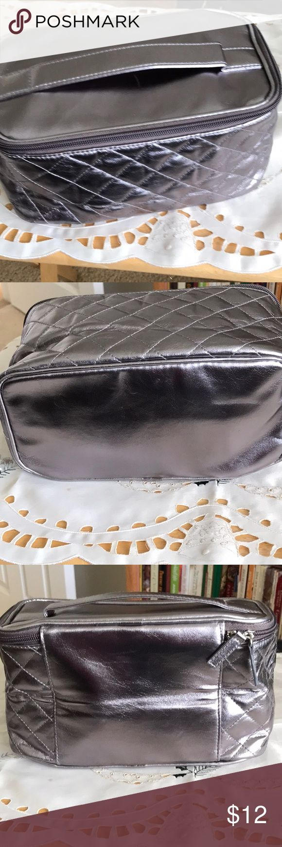 """Avon quilted Train case.  NWOT Avon quilted train/makeup case. Silver in color New, never used, removed f I'm packing to take picture Size 9.5"""" x 4.5"""" x 5.5"""" NWOT, very cute bag Avon Bags Cosmetic Bags & Cases"""