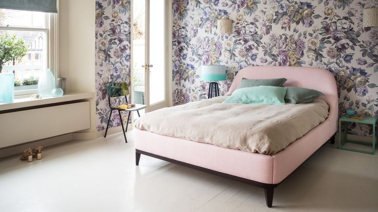 Modern Bedroom With Powdery Pastel Bed And Large Scale Floral Wallpaper