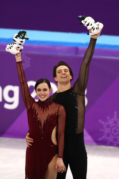 Gold medal winners Tessa Virtue and Scott Moir of Canada celebrate during the victory ceremony for the Figure Skating Ice Dance Free Dance on day eleven of the PyeongChang 2018 Winter Olympic Games at Gangneung Ice Arena on February 20, 2018 in Gangneung, South Korea.