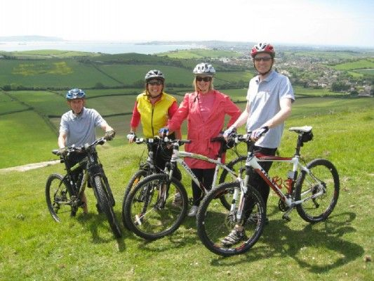 Cycle ride on White Horse Hill overlooking Weymouth Bay and The Isle of Portland ...