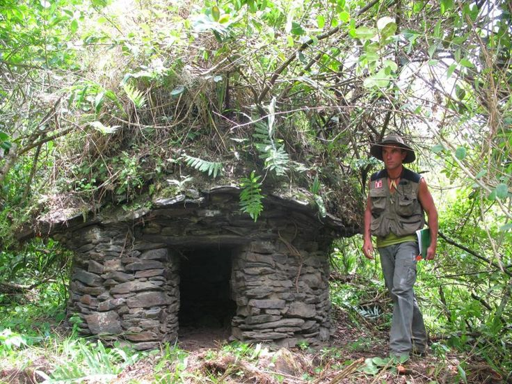 The French explorer Thierry Jamin, near a chullpa, or funeral tower, in the Inca necropolis of Puccro, valley of Lacco. © Photo Thierry JAMIN, 2009.