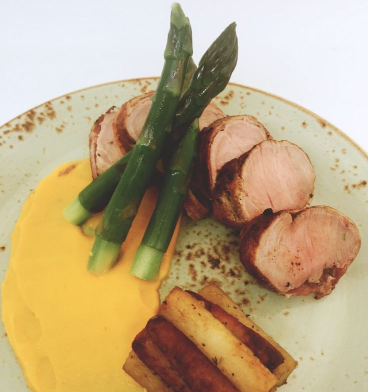 Tenderloin of pork, butternut squash puree, asparagus with fondant potatoes. Perfect for asparagus season.