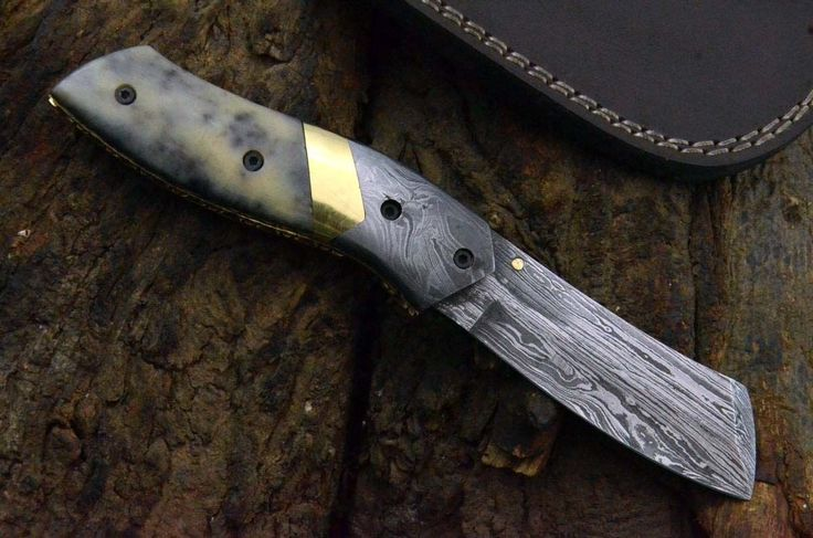 HANDMADE DAMASCUS FOLDING KNIFE. DAMASCUS BOLSTER. THE DAMASCUS STEEL USED FOR THE BLADE IS 200 LAYERS OF HIGH CARBON AND LOW CARBON WELDED/FORGED AND HAMMERED SEVERAL TIME TO OBTAIN UP TO 200 LAYERS.THE HARDNESS OF THE BLADE IS UP TO 58 TO 60 HRC ON ROCKWELL SCALE,IT WILL HOLD SHARP EDGE FOR REALLY LONG TIME.   eBay!