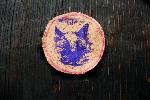 This patch was made from an original ink drawing I did of my sweet bb angel kitten Arwen. Some of the detailing in the eyes was lost and thus Im