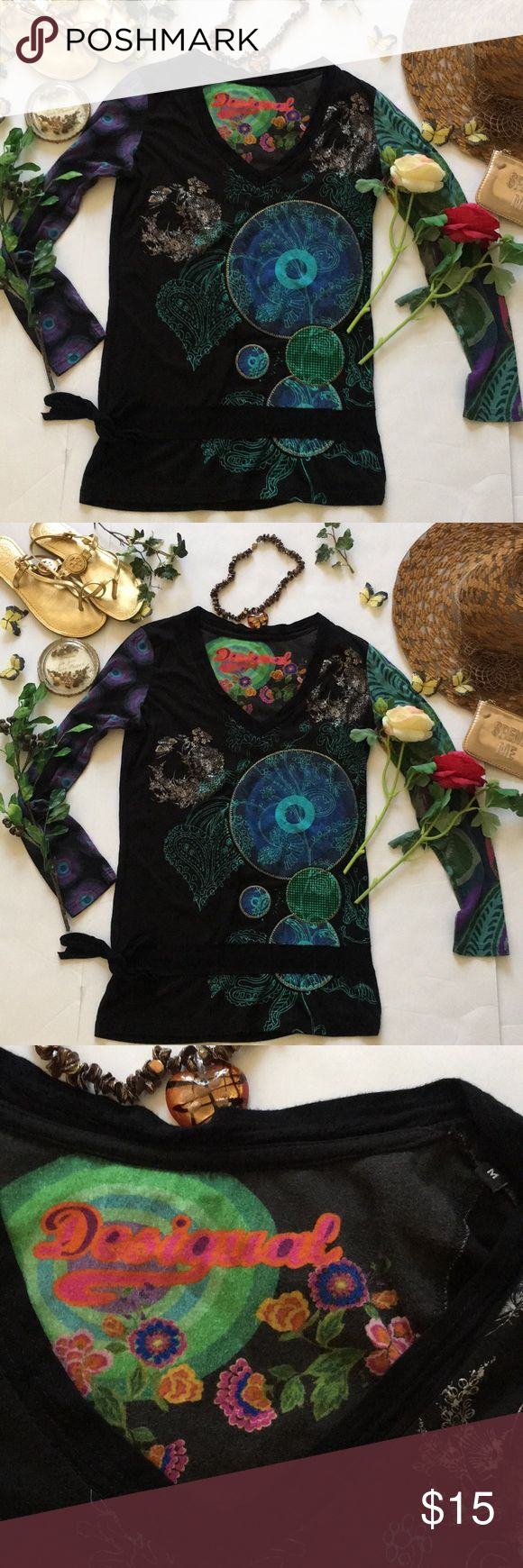 ❤Desigual Top❤ ❤In good used condition Distressed Desigual long sleeve Top in size Medium❤Background color is black❤Has a tie on the bottom right side❤Shows minor sign of wear such as fade and piling for style❤Unknown material❤Please see all photos❤ Desigual Tops