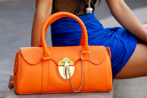 Bright orange bag and royal blue skirt