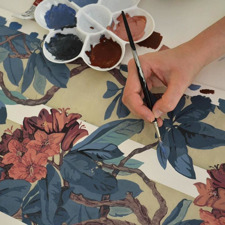 Archive Bourlie wallpaper being extended by hand to complete the pattern repeat in the Cole & Son studio.