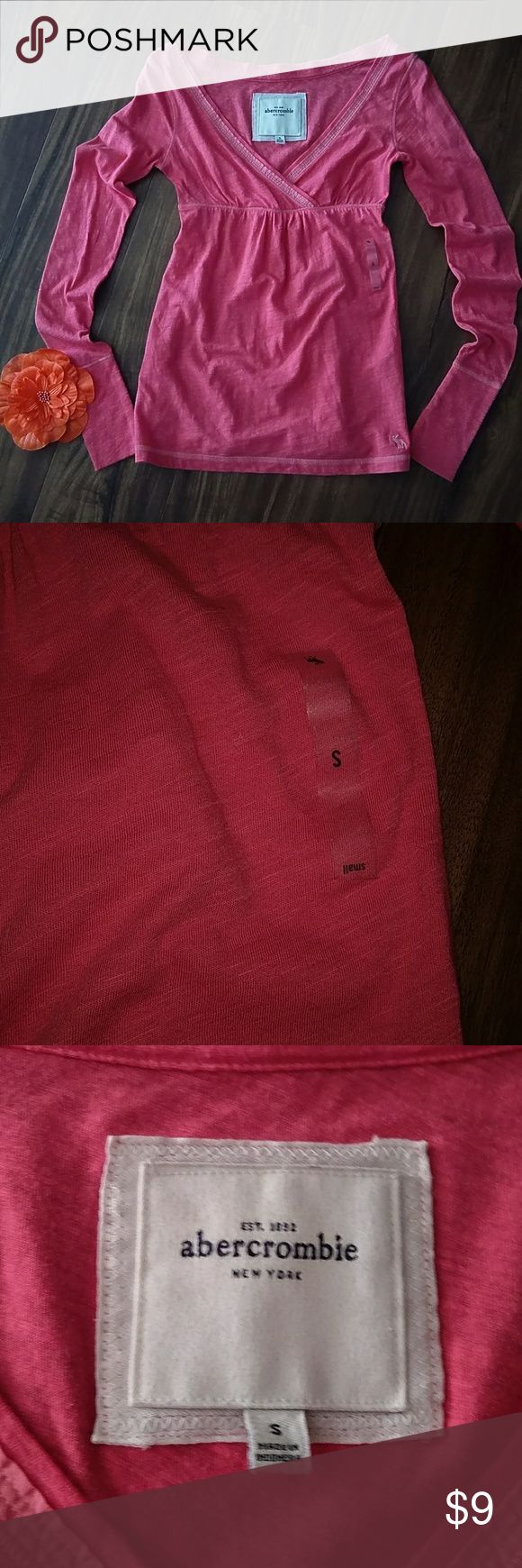 NEW abercrombie girls crossover neckline top This is a new abercrombie girls crossover neckline top in a coral color. Long sleeves. Girls size small. Quick shipping! abercrombie kids Shirts & Tops