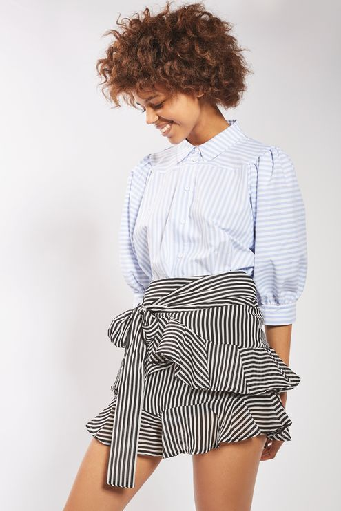 Combining nautical stripes and ruffles, our chiffon mini skirt is ready-made for hot summer nights. Pair down with trainers and a tucked in t-shirt or go glamorous with a coordinating camisole top and heeled sandals.