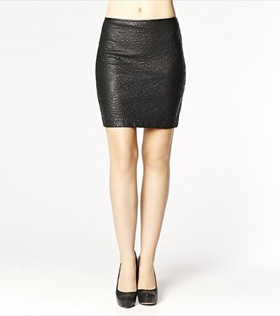 #DYNHOLIDAY This quilted mini faux leather skirt is perfect for a night out! Pair it with one of our wrap blouses and heels for the sexiest look.