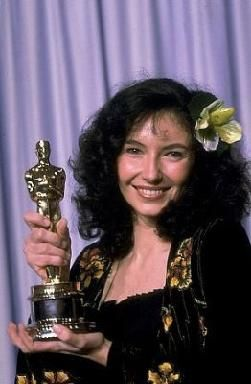 Mary Steenburgen holding Oscar  SHE AND HER HUSBAND TED DANSEN USED TO COME INTO THE STORE